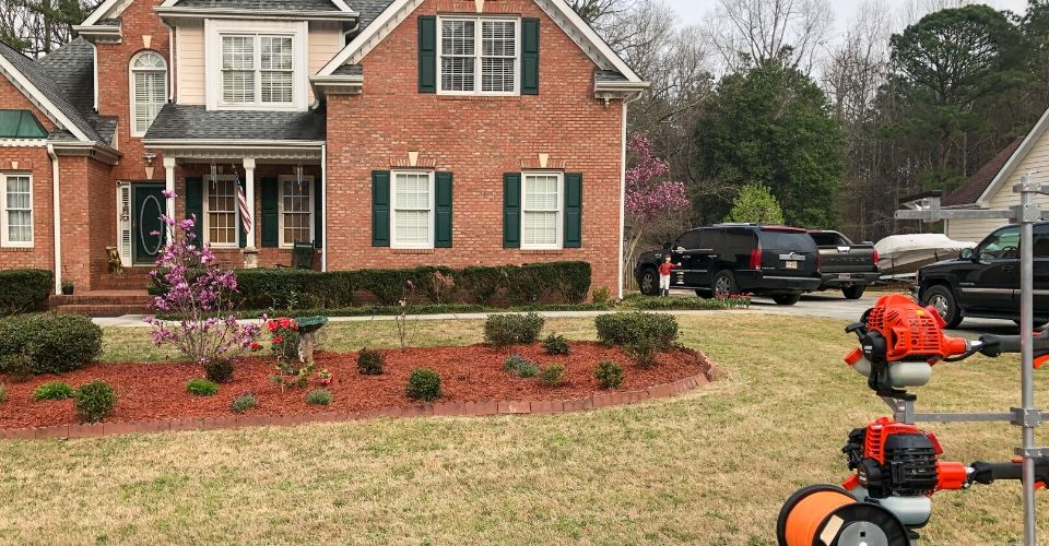 A Gwinnett Lawns Lawn Care client's home in Gwinnett County, GA with lawn equipment.