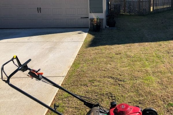 Lawn mower still in a customer's lawn after a lawn mowing service.